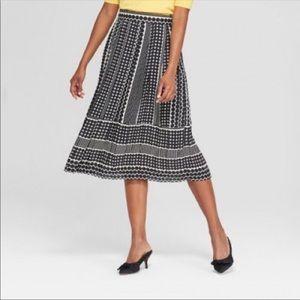 Pleated knee length skirt 16 polka dot black white